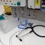 The POM mask next to stethoscope and medical equipment